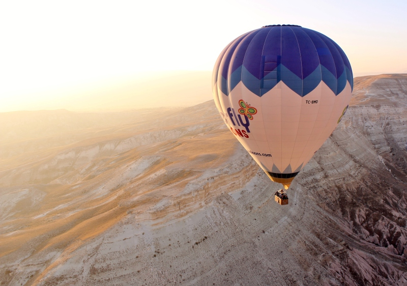 As the sun rises over Cappadocia, you'll enjoy countless breathtaking views of the canyons and rock formations below.