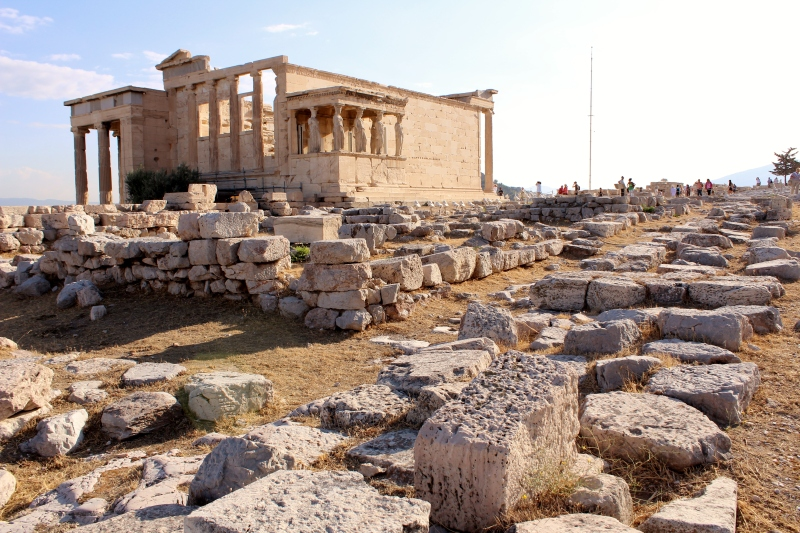 Constructed at the site of the gods' competition, the Erechtheion still bears the marks of Poseidon's trident.